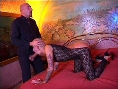 Tattooed floozy gets fucked by horse-hung bald lad on bed