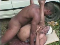 Grown-up black slut having fun outdoor