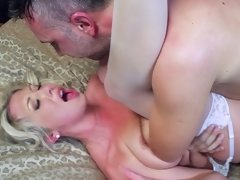 A hot blonde with a nice ass is feeling a cock going up her ass