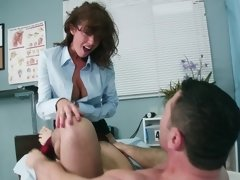 A brunette is getting her wet pussy loved by a man on the bed