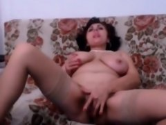 Milf with natural big tits masturbating on webcam