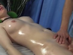 A sassy girl is shaking her tight ass on the massage table for a guy