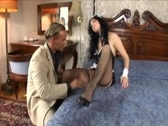 Maid making love in her uniform and besides fishnet stockings