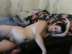 Brunette milf nude at home teasing on webcam
