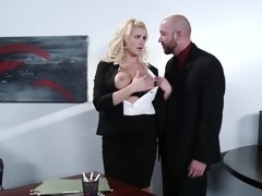A blonde gets undressed and also fucked in the office