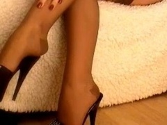 crossed legs in nylon stockings and besides high heels
