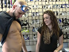 Girls show off tits in swim gear store