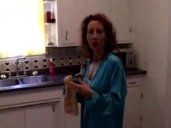 Mature redhead gets fucked in her kitchen