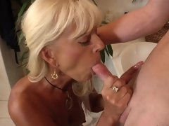 Blonde that has a hot face is sucking a big hard cock