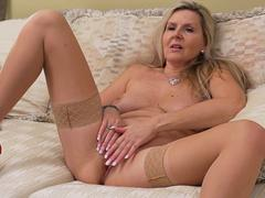 A hot mature slut is teasing in front of webcam naked and starts playing with her favorite dildo