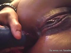 Exotic babe double penetrating herself