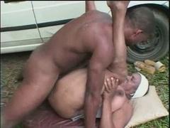 Grown-up black slut having fun outdoor