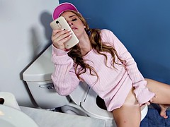 lilly ford fingering herself to porn on her phone in the toilet