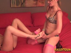 Lesbian gives a foot job to a strap on