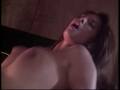 Slutty brunette with natural jugs is doing awesome dick sucking in the room