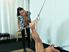skinny brunette mistress whipping her slave