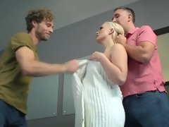 A blonde removes her towel and then she gets two men to fuck her